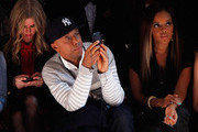 (L-R) Nicky Hilton, Russell Simmons, and Angela Simmons attend the Charlotte Ronson Fall 2012 fashion show during Mercedes-Benz Fashion Week at The Stage at Lincoln Center on February 10, 2012 in New York City.