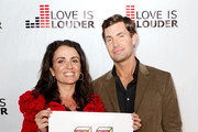 Interior designer Jeff Lewis and his executive assistant Jenni Pulos attends Chaz Dean's holiday party benefitting the Love is Louder Movement on December 1, 2012 in Los Angeles, California.