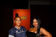 Angela Simmons and Ashanti attend as Cheetos unveiled fan-inspired versions of the #CheetosFlaminHaute look at The House Of Flamin' Haute Runway Show + Style Bar Experience during Fashion Week on September 05, 2019 in New York City.