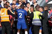 Jose Mourinho, Manager of Manchester United clashes with Maurizio Sarri, Manager of Chelsea during the Premier League match between Chelsea FC and Manchester United at Stamford Bridge on October 20, 2018 in London, United Kingdom.