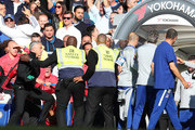 Stewards hold back Jose Mourinho, Manager of Manchester United as he clashes with the Chelsea backroom staff during the Premier League match between Chelsea FC and Manchester United at Stamford Bridge on October 20, 2018 in London, United Kingdom.