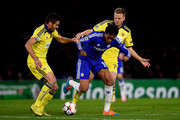 Loic Remy of Chelsea is challenged by Aleksander Rajcevic of Maribor and Ales Mertelj of Maribor during the UEFA Champions League Group G match between Chelsea FC and NK Maribor at Stamford Bridge on October 21, 2014 in London, United Kingdom.