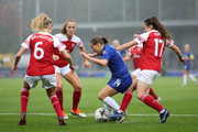Fran Kirby of Chelsea holds the ball whilst under pressure from Arsenal players, during the FA WSL match between Chelsea Women and Arsenal at The Cherry Red Records Stadium on October 14, 2018 in Kingston upon Thames, England.