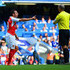 Santi Cazorla Mike Dean Photos - Referee Mike Dean prepares to show the second yellow card to  Santi Cazorla of Arsenal during the Barclays Premier League match between Chelsea and Arsenal at Stamford Bridge on September 19, 2015 in London, United Kingdom. - Chelsea v Arsenal - Premier League