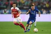 Mateo Kovacic of Chelsea is challenged by Mesut Ozil of Arsenal during the UEFA Europa League Final between Chelsea and Arsenal at Baku Olimpiya Stadionu on May 29, 2019 in Baku, Azerbaijan.