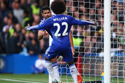 Diego Costa of Chelsea celebrates scoring his team's first goal with his team mate Willian during the Barclays Premier League match between Chelsea and Aston Villa at Stamford Bridge on October 17, 2015 in London, England.