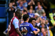 Willian of Chelsea is congratulated by teammate Diego Costa of Chelsea after scoring his team's third goal during the Barclays Premier League match between Chelsea and Aston Villa at Stamford Bridge on September 27, 2014 in London, England.