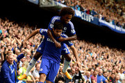 Diego Costa (bottom) of Chelsea is congratiulated by teammate Willian of Chelsea after scoring his team's second goal during the Barclays Premier League match between Chelsea and Aston Villa at Stamford Bridge on September 27, 2014 in London, England.