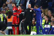 Antonio Conte, Manager of Chelsea argues with Mike Dean the fourth offical during the Premier League match between Chelsea and Huddersfield Town at Stamford Bridge on May 9, 2018 in London, England.