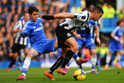 (L-R) Oscar of Chelsea and Hatem Ben Arfa of Newcastle United challenge for the ball during the Barclays Premier League match between Cheslea and Newcastle United at Stamford Bridge on February 8, 2014 in London, England.