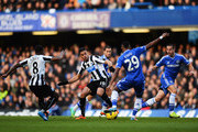 Hatem Ben Arfa (centre left) of Newcastle United and Samuel EtoÂ'o (centre right) of Chelsea challenge for the ball during the Barclays Premier League match between Cheslea and Newcastle United at Stamford Bridge on February 8, 2014 in London, England.