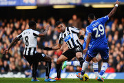Hatem Ben Arfa (centre left) of Newcastle United and Samuel Eto'o (centre right) of Chelsea challenge for the ball during the Barclays Premier League match between Cheslea and Newcastle United at Stamford Bridge on February 8, 2014 in London, England.