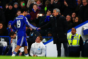 Jose Mourinho, manager of Chelsea shakes hands with Diego Costa of Chelsea as he is substituted during the Barclays Premier League match between Chelsea and Newcastle United at Stamford Bridge on January 10, 2015 in London, England.