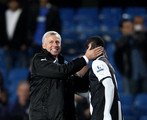 Alan Pardew the Newcastle manager celebrates with two goal hero Papiss Cisse of Newcastle after the final whistle during the Barclays Premier League match between Chelsea and Newcastle United at Stamford Bridge on May 2, 2012 in London, England.