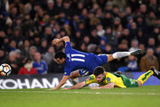 Pedro of Chelsea and Grant Hanley of Norwich City collide and go to ground during The Emirates FA Cup Third Round Replay between Chelsea and Norwich City at Stamford Bridge on January 17, 2018 in London, England.