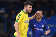 Pedro of Chelsea and Grant Hanley of Norwich City share a joke during The Emirates FA Cup Third Round Replay between Chelsea and Norwich City at Stamford Bridge on January 17, 2018 in London, England.