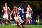 Charlie Adam of Stoke City is tackled by N'Golo Kante of Chelsea during the Premier League match between Chelsea and Stoke City at Stamford Bridge on December 30, 2017 in London, England.