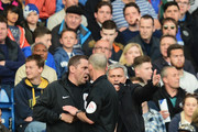 Chelsea manager Jose Mourinho talks to match referee Mike Dean and the fourth official during the Barclays Premier League match between Chelsea and Sunderland at Stamford Bridge on April 19, 2014 in London, England.