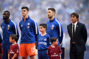 (L-R) Antonio Rudiger, Thibaut Courtois, Gary Cahill and Antonio Conte, Manager of Chelsea sing the national anthem ahead of The Emirates FA Cup Final between Chelsea and Manchester United at Wembley Stadium on May 19, 2018 in London, England.