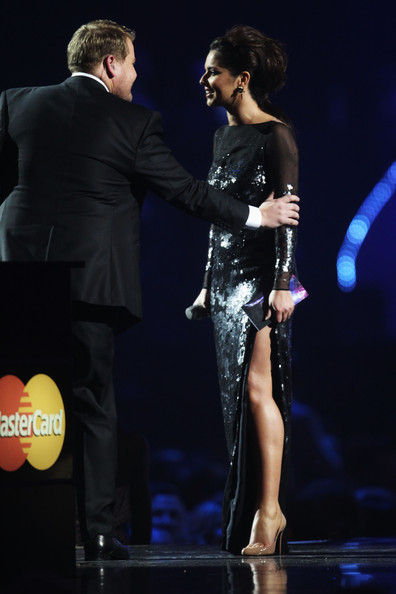 Cheryl Cole (UK TABLOID NEWSPAPERS OUT) Cheryl Cole presents the award for International Female onstage at The Brit Awards 2011 held at The O2 Arena on February 15, 2011 in London, England.