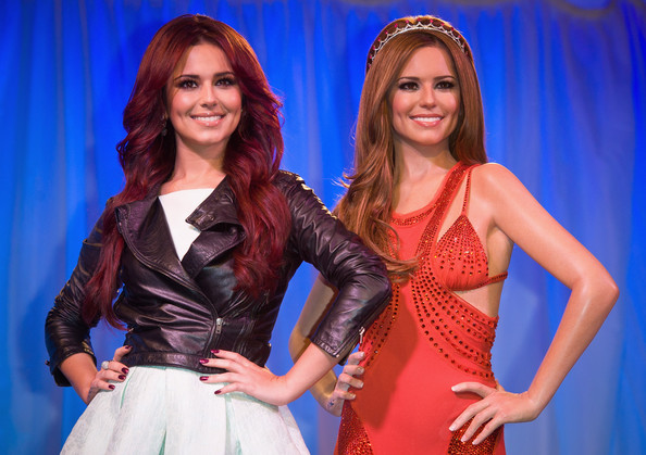 Cheryl Cole Cheryl Cole (L) attends a photocall as her waxwork figure is unveiled at Madame Tussauds on October 20, 2010 in London, England.