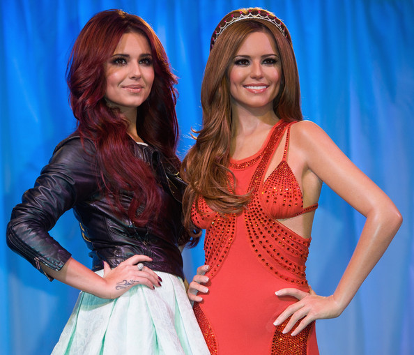 Cheryl Cole Cheryl Cole (L) attends a photocall as her wax work figure is unveiled at Madame Tussauds on October 20, 2010 in London, England.