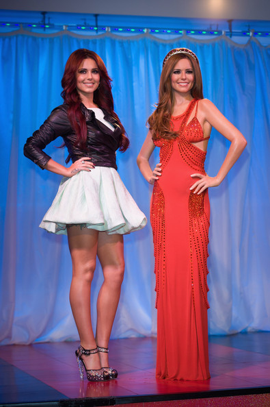 Cheryl Cole Cheryl Cole attends a photocall as her waxwork figure is unveiled at Madame Tussauds on October 20, 2010 in London, England.