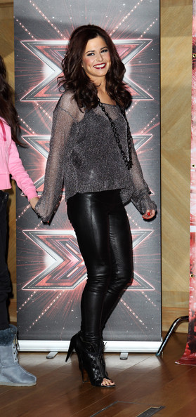Cheryl Cole (UK TABLOID NEWSPAPERS OUT) Cheryl Cole poses for a photocall to promote the X-Factor final held at The Connaught Hotel on December 9, 2010 in London, England.