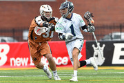Joe Walters #1 of the Chesapeake Bayhawks dodges to the goal against the defense of John Ranagan #31 of the Rochester Rattlers during the first quarter at Eunice Kennedy Shriver Stadium on July 12, 2015 in Brockport, New York.