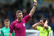 Referee Robert Jones shows a yellow card during the Sky Bet League One match between Chesterfield  and Northampton Town at Proact Stadium on September 17, 2016 in Chesterfield, England.