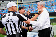 Owner Jerry Richardson of the Carolina Panthers greets NFL officials before a preseason game against the Chicago Bears at Bank of America Stadium on August 9, 2013 in Charlotte, North Carolina.