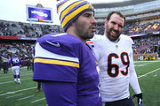 Jared Allen #69 of the Chicago Bears jokes with Christian Ponder #7 of the Minnesota Vikings after the Vikings defeated the Bears 13-9 on December 28, 2014 at TCF Bank Stadium in Minneapolis, Minnesota.