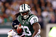 Running back Chris Ivory #33 of the New York Jets carries the ball against the Chicago Bears during a game at MetLife Stadium on September 22, 2014 in East Rutherford, New Jersey.