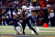 Ka'Deem Carey #25 of the Chicago Bears is tackled by Mark Barron #26 of the St. Louis Rams in the third quarter at the Edward Jones Dome on November 15, 2015 in St. Louis, Missouri.
