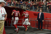 Wide receiver Larry Fitzgerald #11 and defensive back Jamar Taylor #28 of the Arizona Cardinals walk off the field after the NFL game against the Chicago Bears at State Farm Stadium on September 23, 2018 in Glendale, Arizona. The Chicago Bears won 16-14.
