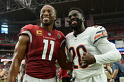 Wide receiver Larry Fitzgerald #11 of the Arizona Cardinals and defensive back Prince Amukamara #20 of the Chicago Bears smile for a photo after the NFL game at State Farm Stadium on September 23, 2018 in Glendale, Arizona. The Chicago Bears won 16-14.