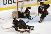 Simon Despres #24 of the Anaheim Ducks slides into the net past goaltender Frederik Andersen #31 and teammate Cam Fowler #4 in the first period of Game One of the Western Conference Finals against the Chicago Blackhawks during the 2015 NHL Stanley Cup Playoffs at Honda Center on May 17, 2015 in Anaheim, California.
