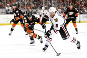 Duncan Keith #2 of the Chicago Blackhawks shoots the puck ahead of Simon Despres #24 of the Anaheim Ducks in the second period in Game Seven of the Western Conference Finals during the 2015 NHL Stanley Cup Playoffs  at the Honda Center on May 30, 2015 in Anaheim, California.