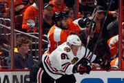 Pierre-Edouard Bellemare #78 of the Philadelphia Flyers is checked by Marian Hossa #81 of the Chicago Blackhawks during the first period at the Wells Fargo Center on March 25, 2015 in Philadelphia, Pennsylvania.