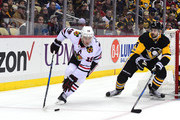 Jonathan Toews #19 of the Chicago Blackhawks skates with the puck  against Justin Schultz #4 of the Pittsburgh Penguins at PPG PAINTS Arena on November 18, 2017 in Pittsburgh, Pennsylvania.