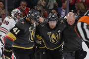 James Neal #18 of the Vegas Golden Knights is helped off the ice by teammate Pierre-Edouard Bellemare #41 and a trainer after Neal was hit by the puck in the first period of a game against the Chicago Blackhawks at T-Mobile Arena on February 13, 2018 in Las Vegas, Nevada.