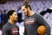 Derrick Rose #1 of the Chicago Bulls talks with Joakim Noah #13 prior to Game Two in the Eastern Conference Semifinals of the 2015 NBA Playoffs 2015 at Quicken Loans Arena on May 6, 2015 in Cleveland, Ohio. NOTE TO USER: User expressly acknowledges and agrees that, by downloading and or using this photograph, User is consenting to the terms and conditions of the Getty Images License Agreement.
