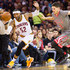 Mo Williams Photos - Mo Williams #52 of the Cleveland Cavaliers tries to stay in bounds after a steal from Doug McDermott #3 of the Chicago Bulls during the first half at Quicken Loans Arena on January 23, 2016 in Cleveland, Ohio. NOTE TO USER: User expressly acknowledges and agrees that, by downloading and/or using this photograph, user is consenting to the terms and conditions of the Getty Images License Agreement. Mandatory copyright notice. - Chicago Bulls v Cleveland Cavaliers