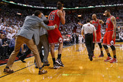 Joakim Noah #13 of the Chicago Bulls is is held back by Derrick Rose after being ejected for arguing with referee Scott Foster #48 during Game Two of the Eastern Conference Semifinals of the 2013 NBA Playoffs against the Miami Heat at American Airlines Arena on May 8, 2013 in Miami, Florida. NOTE TO USER: User expressly acknowledges and agrees that, by downloading and or using this photograph, User is consenting to the terms and conditions of the Getty Images License Agreement.