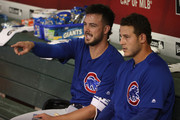 Kris Bryant #17 and Anthony Rizzo #44 of the Chicago Cubs talk in the dugout before the MLB game against the Arizona Diamondbacks at Chase Field on September 18, 2018 in Phoenix, Arizona.