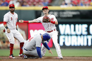 Scooter Gennett #3 of the Cincinnati Reds turns a double play ahead of the slide by Anthony Rizzo #44 of the Chicago Cubs in the third inning at Great American Ball Park on June 21, 2018 in Cincinnati, Ohio.