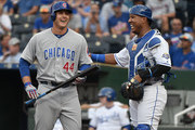 Anthony Rizzo #44 of the Chicago Cubs talks with Salvador Perez #13 of the Kansas City Royals before batting in the first inning at Kauffman Stadium on August 6, 2018 in Kansas City, Missouri.