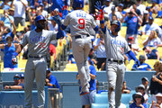 Jason Heyward #22, Albert Almora Jr. #5 and Javier Baez #9 scored on a double by Anthony Rizzo #44 of the Chicago Cubs in the seventh inning of the game against the Los Angeles Dodgers at Dodger Stadium on June 28, 2018 in Los Angeles, California.