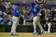 Kris Bryant #17 of the Chicago Cubs is congratulated by Anthony Rizzo #44 after hitting a home run in third inning against the Miami Marlins at Marlins Park on March 30, 2018 in Miami, Florida.