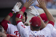 Aaron Altherr #40 of the Philadelphia Phillies high fives Andres Blanco #4 after his solo homerun in the bottom fo the second inning against the Chicago Cubs on September 11, 2015 at Citizens Bank Park in Philadelphia, Pennsylvania.